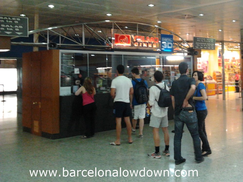 Some people queing to buy tickets at the Icaria english language cinema Barcelona