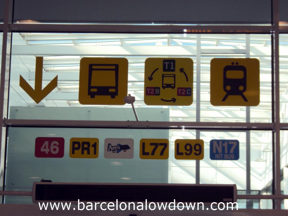 Colourful signs at Barcelona Airport