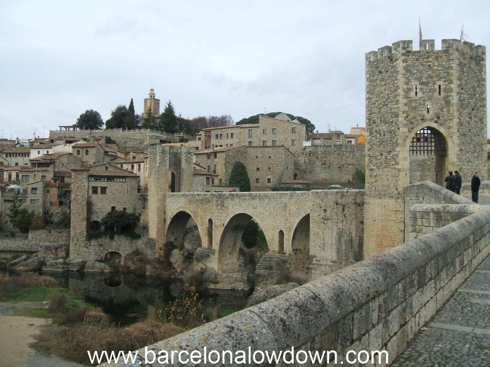 Approaching Besalu across the medieval stone bridge.