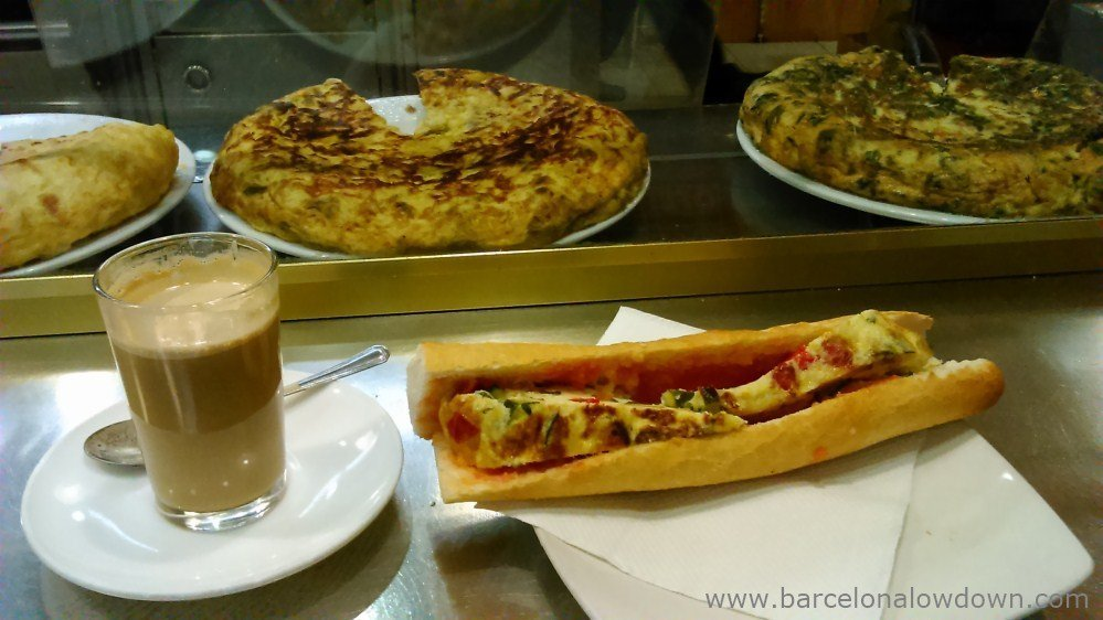 Traditional Spanish breakfast - a cup of coffe and an omlette sandwich