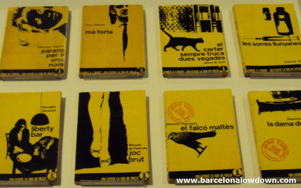 A collection of black and yellow book covers at DHUB Barcelona