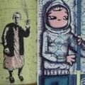 Close up of graffiti in Barcelona. An old lady withy a spray can and a young girl with a paint roller.