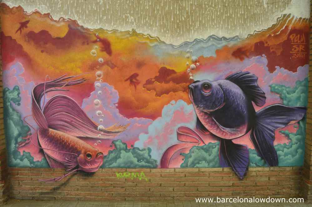 2 goldfish looking worried as it rains street art in Barcelona