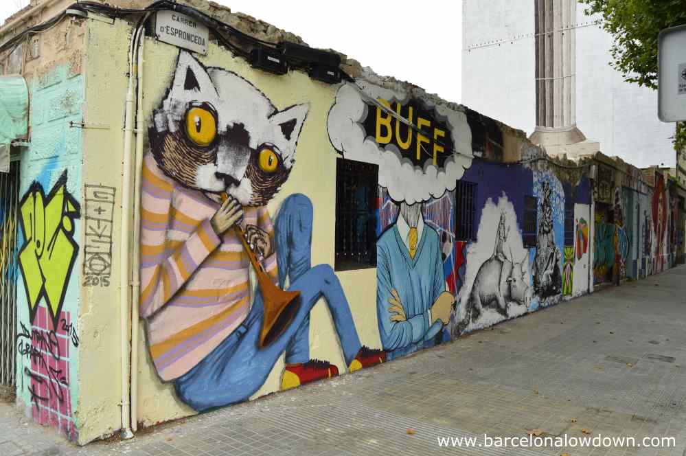 Surreal Barcelona street art. A cat playing a clarinet.