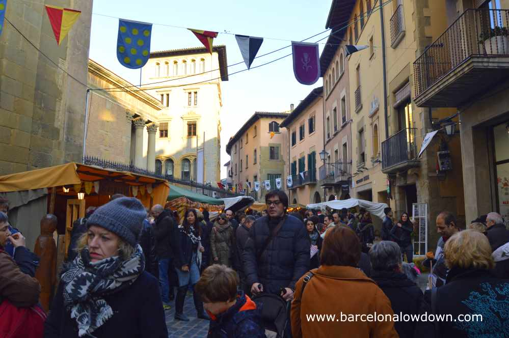 Busy streets full of people and stall selling traditional mediaval products, Vic near Barcelona