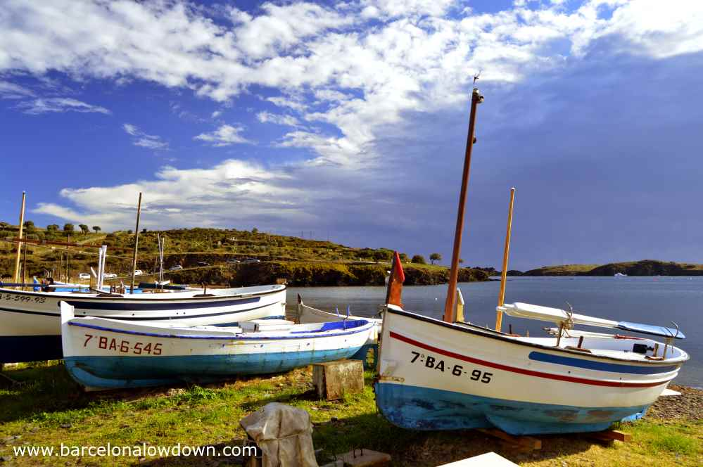 Traditional fishing boats dragged up onto land in the cove of Prtligat near Cadaqués on the Spanish Costa Brava