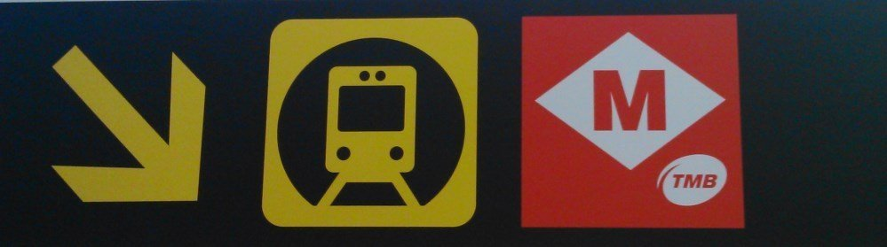 Sign indicating how to get to the metro station at Barcelona airport terminal 1