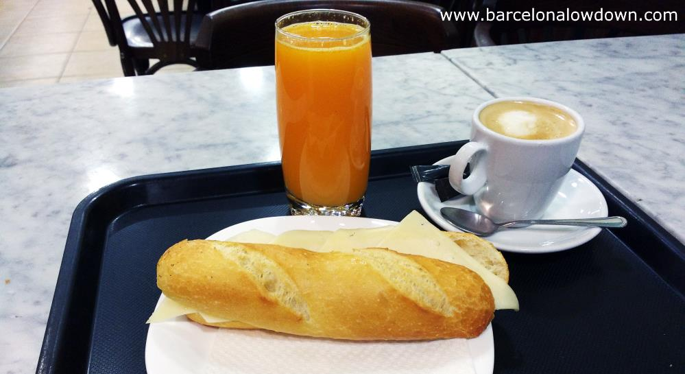 A typical Spanish breakfast in Barcelona consists of a sandwich, orange juice and coffee