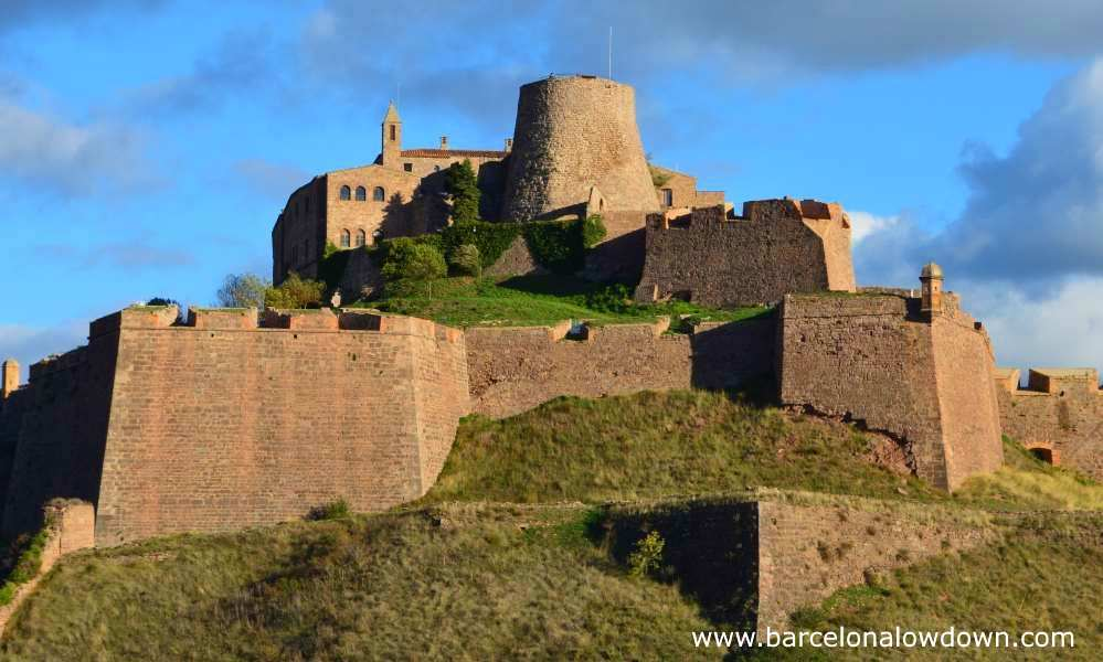 Photo of Cardona castle taken at the viewpoint in Cardona old town. The photo shows a clear view of the bastions which date back to the 17th century and the medieval Minyona tower which was built in the 9th century by Wilfred the Hairy of Barcelona.