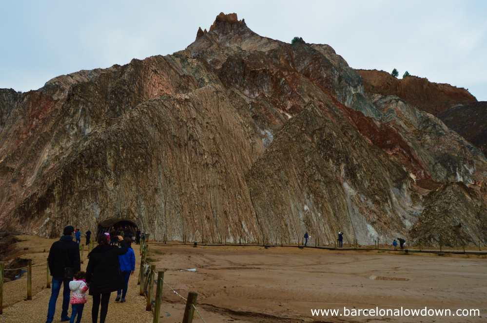Visitors approaching the salt mountain in Cardona Muntanya de Sal cultural park before entering the minas nieve salt mine