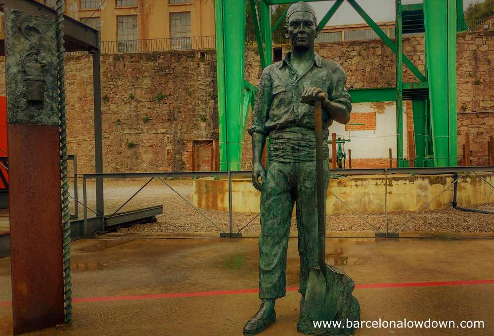 Bronze statue of a miner near the entrance to Cardona salt mountain natural park, 100km from Barcelona