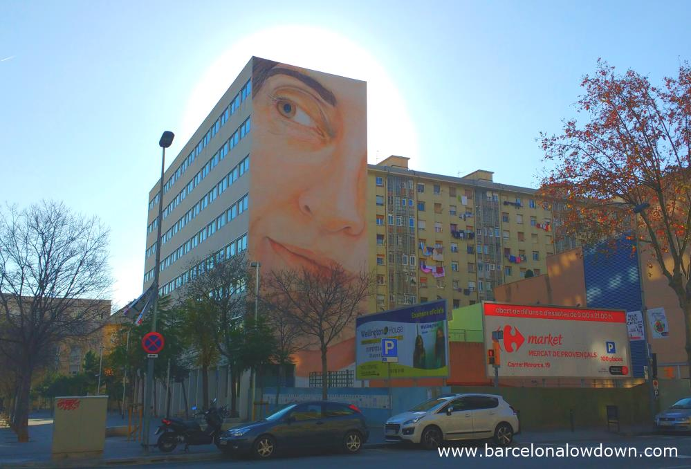 Giant mural super realistic portrait of a woman painted by Jorge Rodriguez Gerada in the Sant Martí district of Barcelona Spain