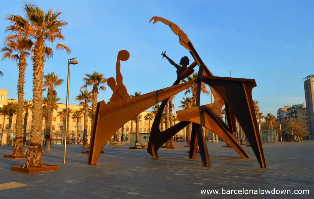 The homage to swimming monument on the Barceloneta beach in Barcelona early in the morning when nobody is about