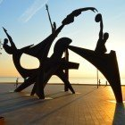 Homage to swimming monument at sunrise on Barcelona beach
