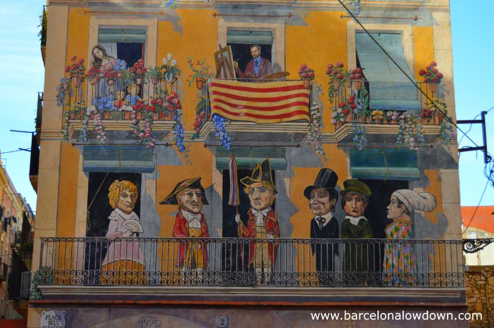 Section of the mural painted on a building in Placa dels Sedassos, Tarragona Spain