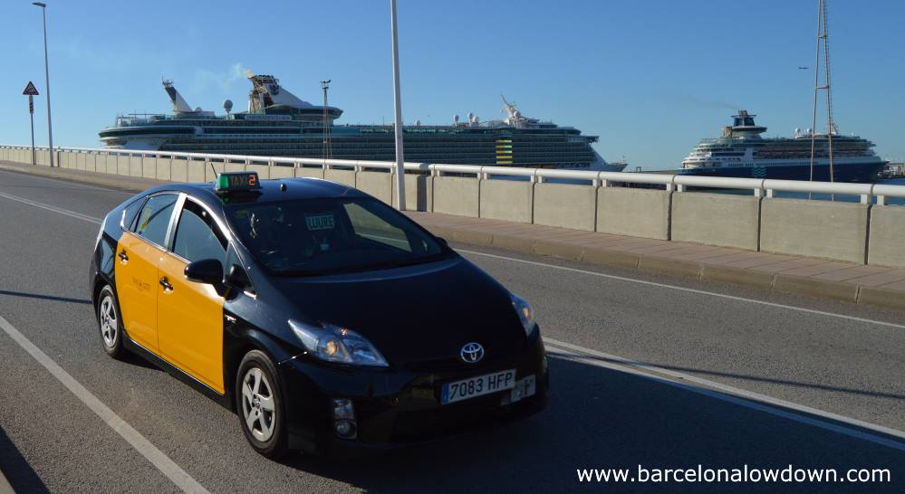 A taxi bringing passengesr from their ships to Barcelona city centre.