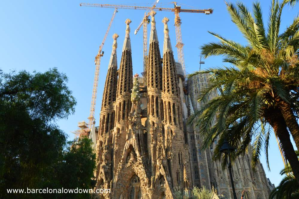 Antoni Gaudi's Sagrada familia as seen from the small park next to the temple