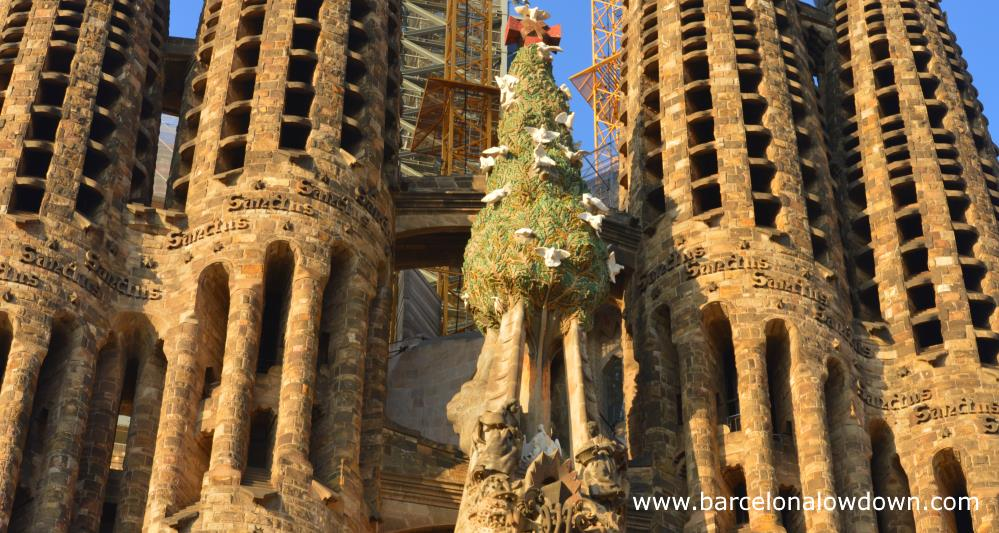 Close up of the bell towers of the nativity façade of the Sagrada Familia Basilica in Barcelona. Tou can see the Christmas tree with 12 doves as well as part of 4 bell towers.