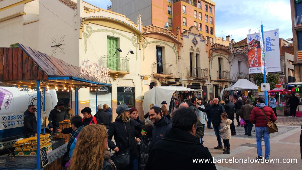 People visiting the stalls at the Fira de la Candelera winter fair, Molins de Rei, Barcelona, Catalonia, Spain