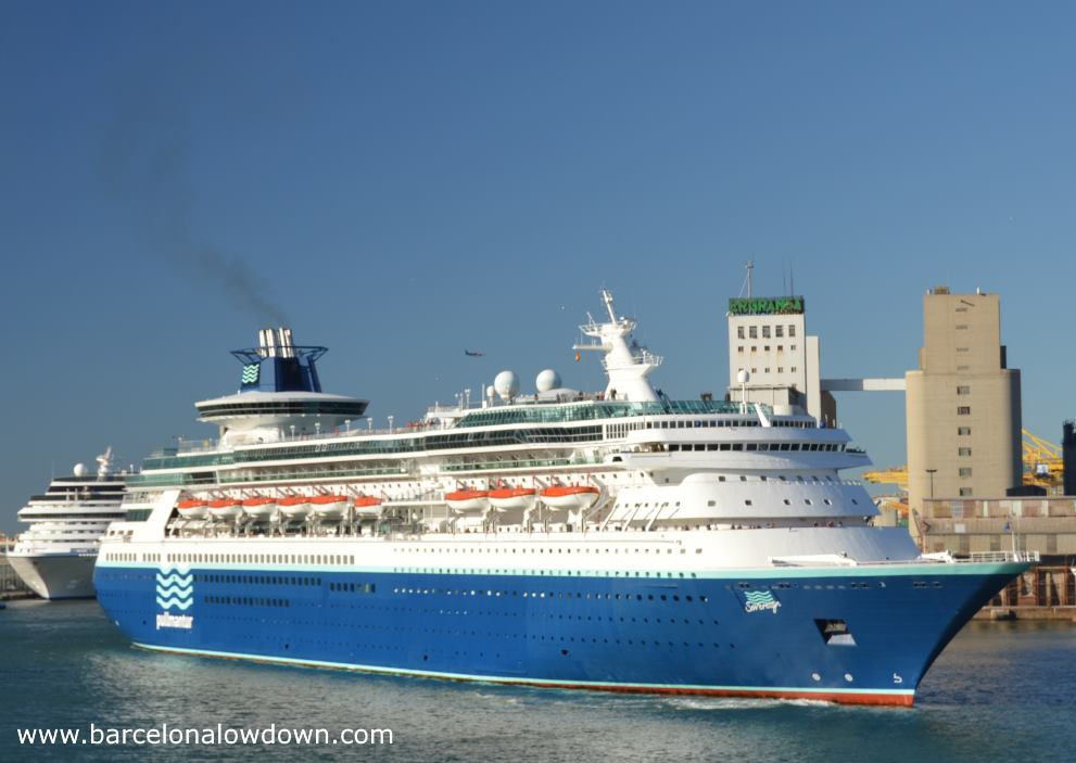A blue Pullmantour cruise liner docking at the Moll Adossat wharf Barcelona