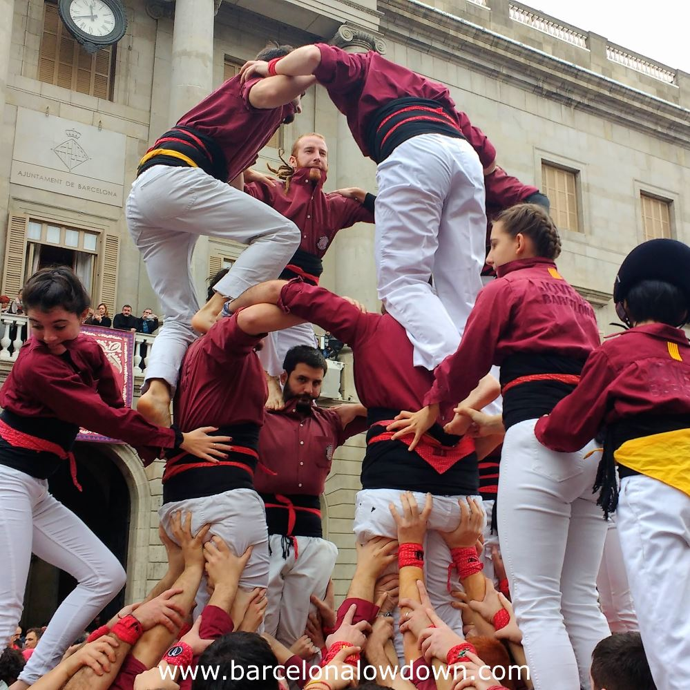 A team building a human tower during a local festival in Barcelona